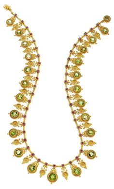 Antique Etruscan Revival Peridot, Ruby, Gold Necklace, Successori Marchesini, circa 1870. Featuring graduated round-cut peridots enhanced by round-cut rubies set in 18k gold, with an applied plaque marked Successori Marchesini. #Marchesini #EtruscanRevival #antique #necklace