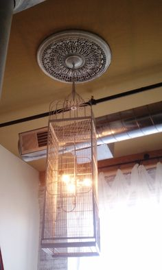 Birdcage transformed into lighting fixture. Purchased from Brimfield Fair.