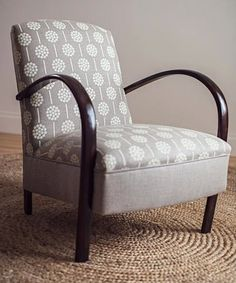 love this reuphostered chair with fabric from thea and sami