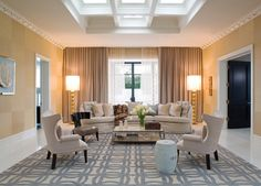 modern living room by Jamie Herzlinger  tall standing light to accent space
