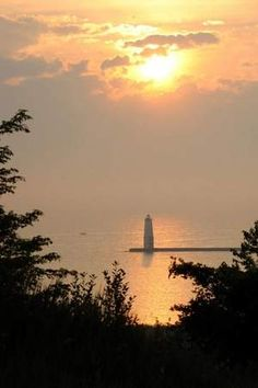 Seven Wonders of Michigan. A sunset view of the Frankfort pier from the Elberta Bluffs.