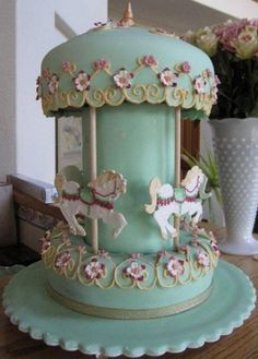 """Pretty carousel cake with instructions. Thanks to the maker for her generosity in sharing the """"how-to""""!"""