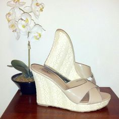 """Charles by Charles David Nude Heels Gorgeous wedges with crisscross straps. Wedge 4"""", platform 1"""". Rubber sole. Open toe. Nude color. See 4th photo showing minor damage. EUC!!  No modeling!  Price firm unless bundled...NO OFFERS!! Charles David Shoes Wedges"""
