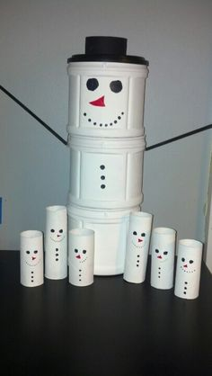 DIY Christmas decorations...I painted snowmen using old coffee tins and paper towel rolls