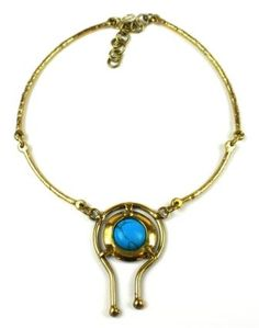 Handmade by South African artisans, this  striking necklace with a hook closure culminates in the center with a  large turquoise stone embedded in an asymmetrical setting.Necklace dimensions : 2 mm wide x 18 inches long with a 2.5-inch extension.