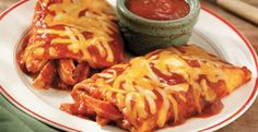 5-Minute Cheesy Chicken Enchilada Grande Recipe http://www.kitchendaily.com/recipe/5-minute-cheesy-chicken-enchilada-grande?icid=maing-grid7%7Cmain5%7Cdl22%7Csec3_lnk3%26pLid%3D294177