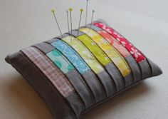 another lovely pincushion, colorful and made with scraps of fabric -- Clarissa