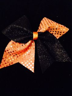 Large cheer bow black glitter and orange sequin cheer bow. Great for halloween!! All of my cheer bows are attached to a high quality No Metal