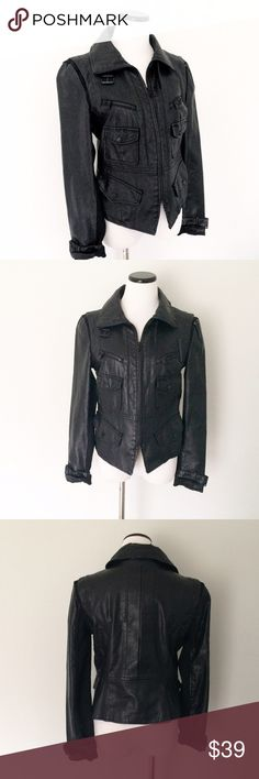 Kenneth Cole Black Moto faux leather Jacket Kenneth Cole Reaction black faux leather Moro jacket. This jacket is bad a$$! This was my go-to jacket for a night out with the girls and especially rock concerts.!! Multiple buckles and pockets, zippers. Black fabric strip on shoulders. Great condition, except for the peeling patch on crease of collar. You can't see it if you have long hair or if you pop the collar. Overall, jacket is amazing and so much fun! I always wore the sleeves rolled once…