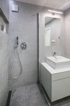 Firma, která interiér realizovala, ráda vytváří zděné sprchové kouty kvůli variabilnosti rozměrů a efektnímu vzhledu; Archiv studia