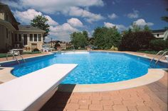 Backyard Swimming Pool With White Diving Board : Adding A Diving Board To Your Outdoor Pool