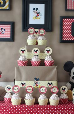 Mickey Mouse party tablescape with a great backdrop of framed Mickey prints.