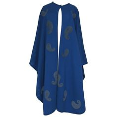Christian Dior Knit Paisley Appliqué Cape | From a collection of rare vintage coats and outerwear at https://www.1stdibs.com/fashion/clothing/coats-outerwear/
