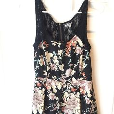 Floral dress adorable summer dress! Have lace backing with zipper. Back lace is a little distressed but still in great condition Charlotte Russe Dresses