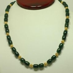 16 in.(40.6 cm) Jade necklace, interspersed with 18K yellow gold. ...