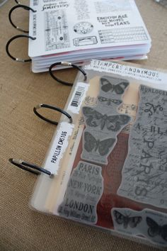 "stamp storage tip - Tim Holtz ""unmounted stamp pocket refill pages"" http://www.ebay.com/itm/Advantus-Cropper-Hopper-Tim-Holtz-Unmounted-Stamp-Refill-Pockets-/370755730435?pt=LH_DefaultDomain_0=item5652c37c03] to store stamps. 7x8.5+pockets. Stamp image on  paper & tape INSIDE the pocket. Secure stamp over the image. Bind with ""black rubber binding rings"" from 7gypsies; same exact size as the Stampers Anonymous sets"