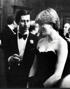 """First royal function as the officially engaged Prince of Wales & Lady Diana Spencer, (wearing the infamous """"shocking"""" strapless black gown)"""