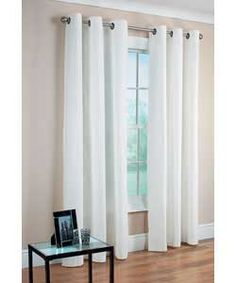 these curtains could look nice for the sliding door to the patio...I think a black rod would really pop on the light grey wall!