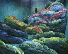 Nightscape by Korean artist Jee Young Lee. Lee uses no photo manipulation to create her images. Her setting is always her small studio in Seoul, the longest wall of which is less than 14 feet. To build a single iteration can take weeks or even months. After each session, Lee photographs an aerial shot of the scene (herself always included). Then, like the Buddhist monks who build sand sculptures only to let them scatter, she dismantles her work and starts all over.