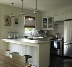 Love the feel of this kitchen and the lights!