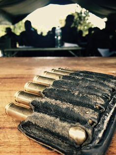 The ammo pouch on the table while teaching safety in rifle handling to Tanapa rangers