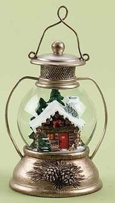 "6"" Lantern with Wintery Log Cabin Scene Christmas Snow Globe Glitterdome by Roman. Save 6 Off!. $15.95. From the Glitterdome CollectionItem #35785Rustic style lantern-shaped snow globe with antique brass-colored finish and pine cone embellishments features a wintery log cabin scene inside with falling iridescent glitter and ""snow"" Dimensions: 6""H x 3.25""W x 3""D Material(s): resin/glass"