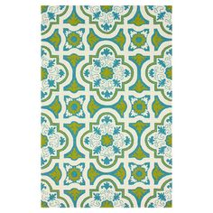 Anchor your sunroom or patio seating arrangement in chic style with this elegant indoor/outdoor rug, showcasing a quatrefoil motif in lime.