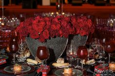 Edgy fantasy table of red roses in silver studded vases at the 2014 Montefiore Gala - By Flowers of the World #nyc #design #waldorf=astoria #roses