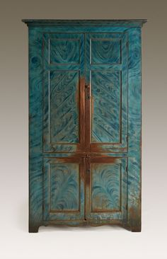 "Dimensions: Ht. 81"", W. 47 ¼"", D. 19""  Date / Circa: c. 1820-40  Maker / Origin: Hunterdon County, New Jersey (Delaware Valley)  Medium: Pine with the original blue paint-decorated finish – quite rare. Original red-painted interior, shelves with carved plate grooves.  Miscellaneous: 2 ½"" extended feet to restore original height."