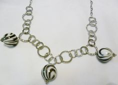 For the wild one on your list....Necklace Silver Circle Chain featuring Three Large  by CindyDidIt, $24.50