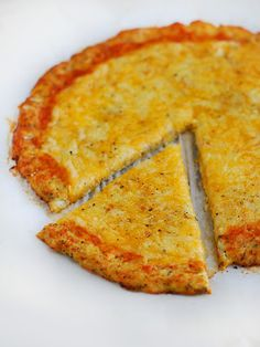 Low Carb Cauliflower Pizza Crust Recipe. Top with diced tomatoes, and your favorite veggies.