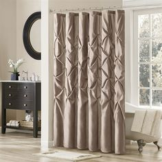 Update your bathroom instantly with the Laurel Shower Curtain. Its deep taupe color paired with large tufting creates a contemporay look while adding value to your space. Made from 100% polyester polyoni, this shower curtain is machine washable for easy care.