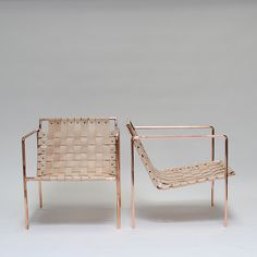 gorgeous rose gold + veg leather chairs. Architectural Digest Home Design Show — Eric Trine