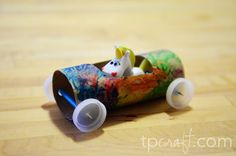 Toilet Paper Tube Racer. Put a toothpick through a straw to make the axle. (Leave the cardboard flap attached and fold up to make a windshield.)
