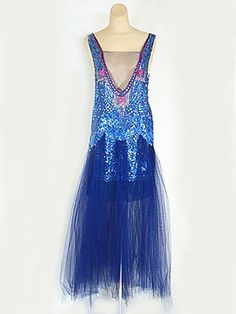 Couture-quality unlabeled evening dress of sapphire tulle, c.1921. The torso is beaded with Egyptian motifs in iridescent textured sequins.