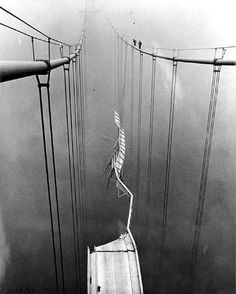 The misdesigned Tacoma Narrows Bridge after it collapsed in 1940.  Note the men standing on the cable.
