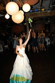 A great bouquet throw by a bride with an Alice in wonderland wedding theme! http://www.creative-theme-wedding-ideas.com/alice-in-wonderland-wedding-reception.html