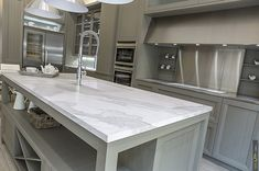 Gorgeous kitchen siland surface is easy to maintain and lasts much longer than traditional tiles