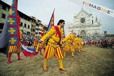 Calcio Storico:  Before each game is played, a long and solemn procession starts from Piazza Santa Maria Novella  and winds through Florence till it reaches Borgo Santa Croce with much fanfare and trumpets. Horsemen follow with foot soldiers in armor, completely suited with the ancient Florentine helmets and corsalets of leather. Twenty drummers perform in sync, wearing dashing yellow and blue silk tunics with the famous crimson lily of Florence.