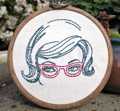 I love this embroidery hoop, even though sewing is my arch-nemesis.  The design reminds me of the Smart Women Thirst for Knowledge juice glass over at the BUST magazine store.  So much spectacle love.