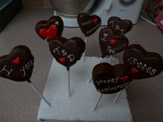 Anniversary cake pops for my husband made from the trimmings of the ferrari cake. Made frim rich chocolate fudge cake and ganache