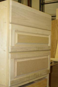 3 drawer base cabinet . No doors .