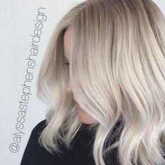 ice blonde platinum blonde blonde balayage textured bob cut babylights Cool blonde highlights shadow root