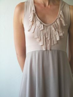 dress for success: this beautiful fringed dress whispers fashion and feminitiy