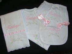 Personalized 4 Piece Baby Gift Set Onesie/Diaper Cover/Burp Cloth/Bib Monogrammed. $49.99, via Etsy.
