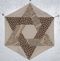 tutorial for this awesome block...hmmm woven triangles or Star Of David hexies...either way, nice!