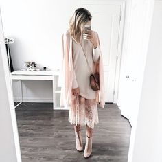 Pretty neutrals in a lace dress, light sweater covered by a blush cardigan, and nude ankle boots.