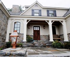 Curb appeal inspiration: shutters, wooden door, natural stone, neutrals