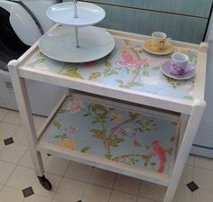 Laura Ashley summer palace wallpaper added to vintage tea trolley. Mine looks vintage but was made by my husband. Lucky me!