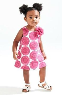 Adorable! Pretty pink embroidered dress paired with white sandals.